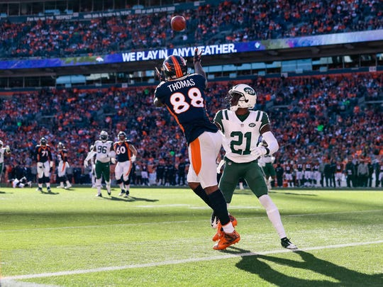 Dec 10, 2017; Denver, CO, USA; Denver Broncos wide receiver Demaryius Thomas (88) makes a catch for a touchdown as New York Jets cornerback Morris Claiborne (21) defends in the first quarter at Sports Authority Field at Mile High. Mandatory Credit: Isaiah J. Downing-USA TODAY Sports