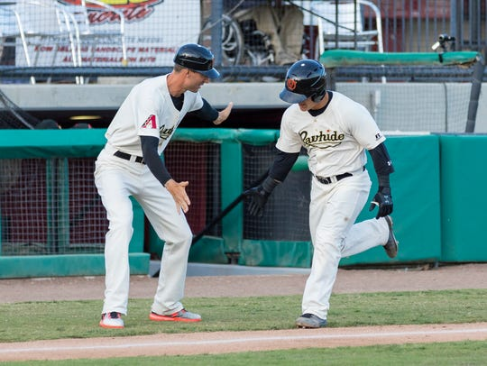 Visalia Rawhide catcher Daulton Varsho, right, celebrates