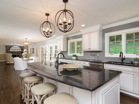 Owners expanded the space off the kitchen to create an open floor plan with multiple seating areas.