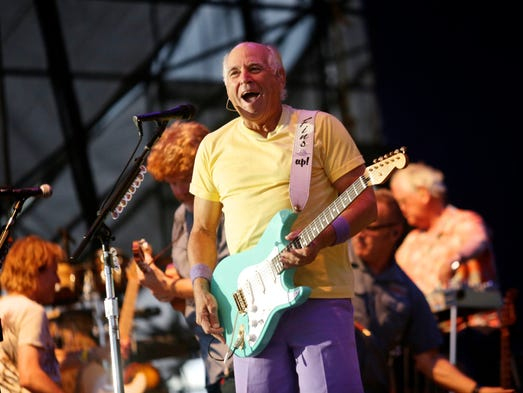 Jimmy Buffett performs for the crowd on Thursday, June