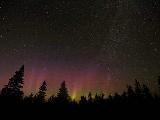The aurora borealis, or northern lights, shine above