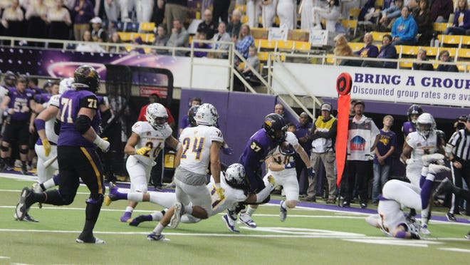 Members of the Western Illinois defense make a tackle during a game at Northern Iowa last fall.
