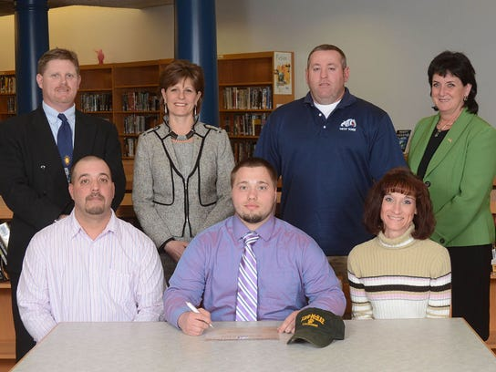 Jordan Lombardo will play lacrosse at Lees McRae College Back Row: Roger Czerwinski, AD, Dr. Emilie Lonardi, Superintendent, Rodney Tamblin, coach, Ms. Janet May, Principal Front Row: Dad, Mr. John Lombardo, Jordan, Mom, Mrs Pam Lombardo (SUBMITTED)