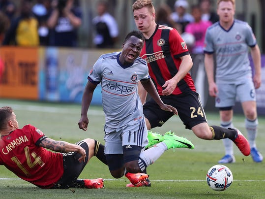 Chicago Fire forward David Accam turns the ball over on a double-team by Atlanta United defenders Carlos Carmona, left, and Julian Gressel during the second half of an MLS soccer match Saturday, March 18, 2017, in Atlanta. (Curtis Compton/Atlanta Journal-Constitution via AP)