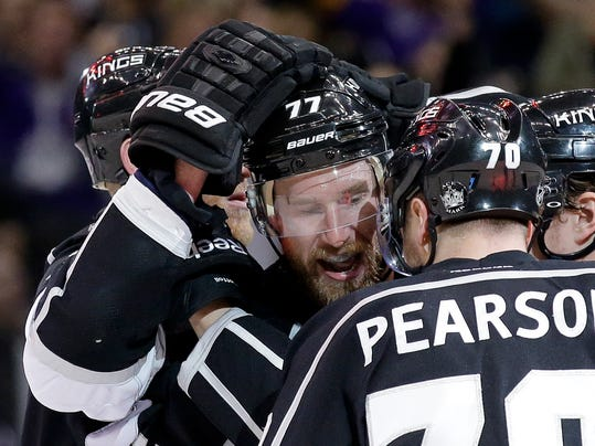 Los Angeles Kings center Jeff Carter (77) celebrates his goal against the Chicago Blackhawks with Tanner Pearson during the second period of Game 3 of the Western Conference finals of the NHL hockey Stanley Cup playoffs in Los Angeles, Saturday, May 24, 2014. (AP Photo/Chris Carlson)