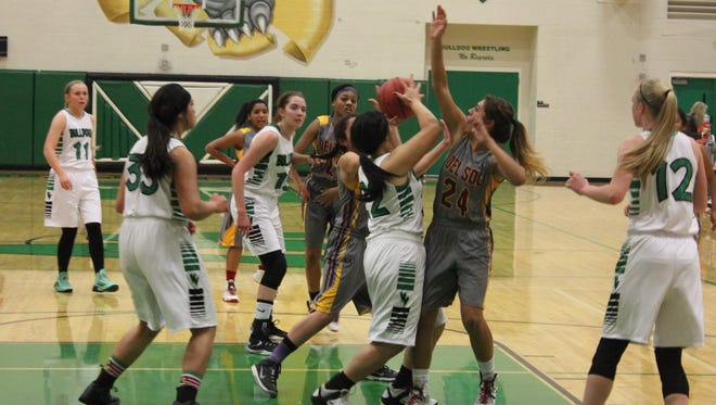 Virgin Valley High School's Jannella Fiso battles Del Sol players for a rebound during a basketball game Tuesday, Dec. 15, 2015 at VVHS.