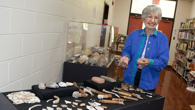 Anne Holt, director of Mainstreet Monticello, displays artifacts that are part of the collection at the Jefferson County Dick Bailar Library.