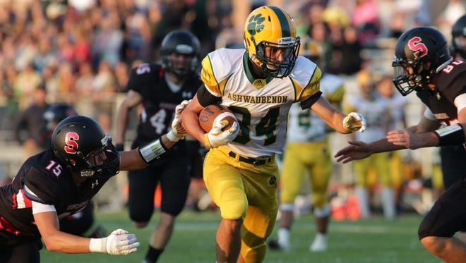 Ashwaubenon's David Clark hauls in one of his three first-half touchdown receptions from Will Ark at Sheboygan South on Friday.