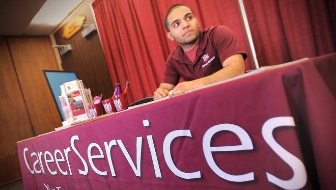 NMSU student and Career Services Department employee Jesus Martinez was on hand to answer questions during a career fair held in the Corbett Center ballrooms. The event was cosponsored by Career Services and the College of Engineering.