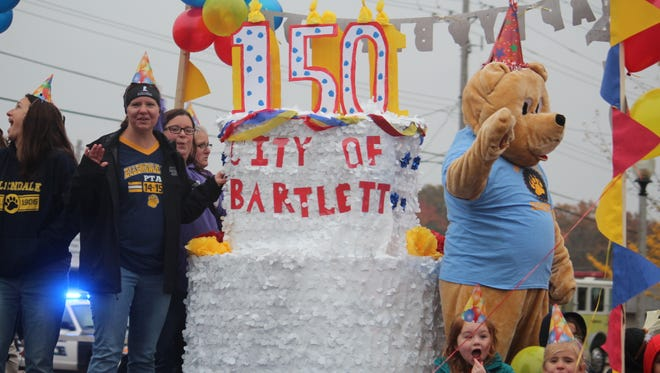 "Ellendale Elementary's ""Let's Celebrate"" Christmas float, featured a giant birthday cake at the ""Happy 150 Years Bartlett,"" Christmas Parade on Dec. 3. The float created by school staff and students won third place in the Santa's Trophy (Schools) category."