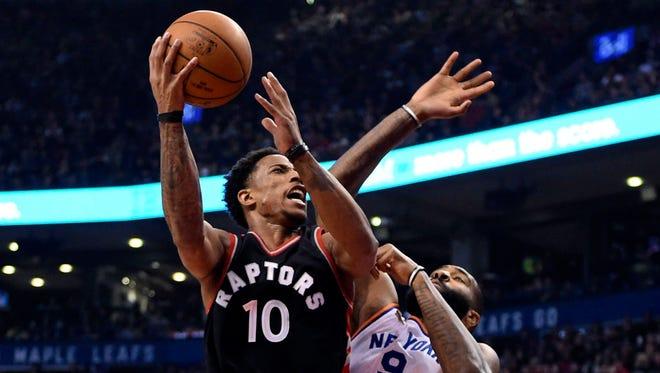 Toronto Raptors guard DeMar DeRozan (10) drives against New York Knicks center Kyle O'Quinn (9) during first-half NBA basketball game action in Toronto, Sunday, Jan. 15, 2017.