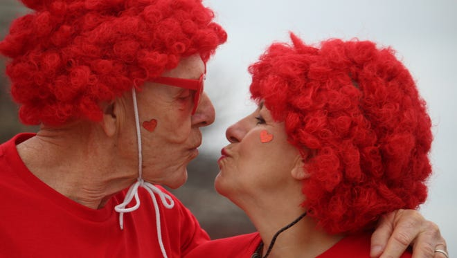 Sweethearts, Bruce and Faye McHaney, gave each other a kiss for luck before the race on Feb. 11, at the annual Valentine's Day 5K and 10K Walk & Run hosted by the Bartlett Parks and Recreation Department.