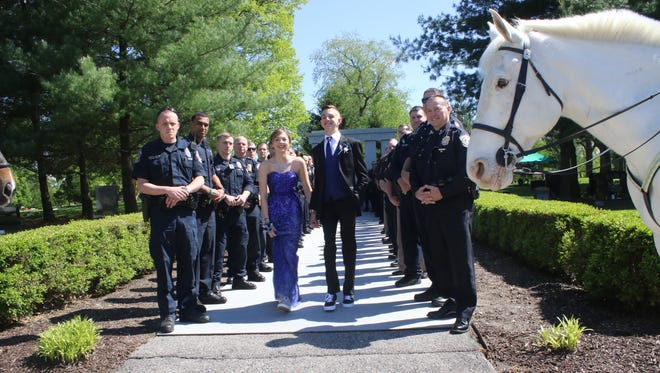 Police officers surprised Sierra Bradway for her prom. Her father, IMPD Officer Rod Bradway, was killed in the line of duty in 2013.