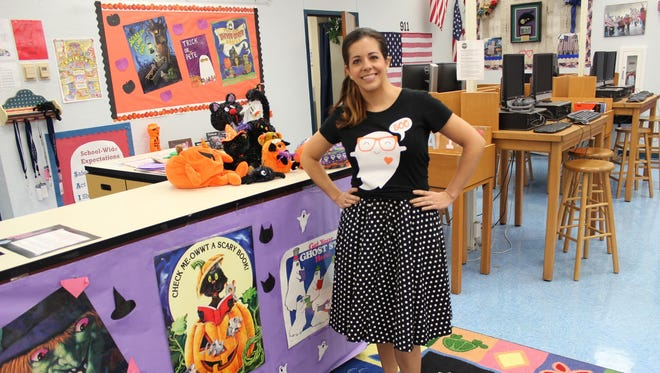 Northport fifth grade Rising Stars Gifted instructor Lorri Lamm makes the day enjoyable for her students by dressing as a sock hop teacher.