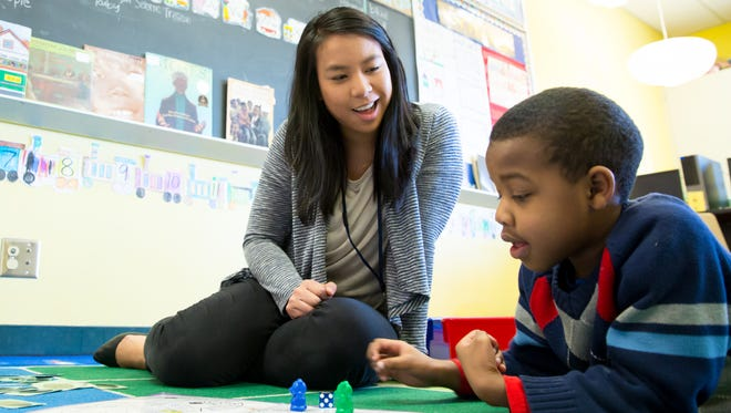 Bethany Poon works with Jaylen McMillan, 7,  and is a teacher resident in Seattle Public Schools. She is co-teaching kindergarten-first-graders.