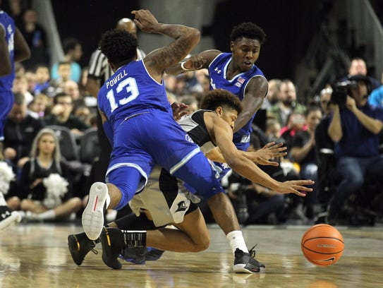 Seton Hall guard Myles Powell (13) trips up Providence