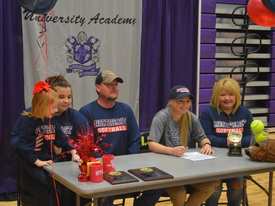 University Academy second baseman Sydni Soileau (second right) signed with Northeast Texas Community College Thursday.
