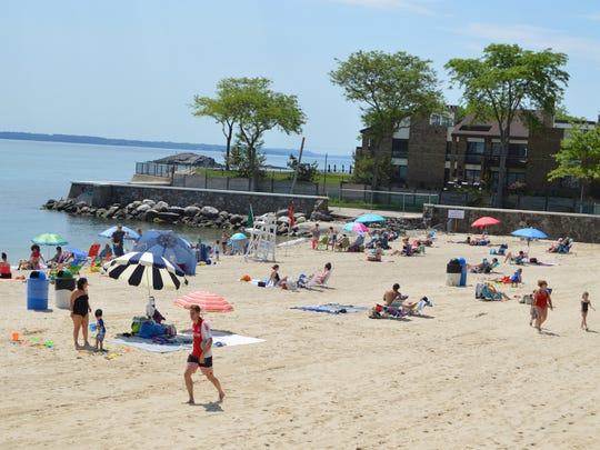 Locals take to the sandy beach at Rye Town Park, June