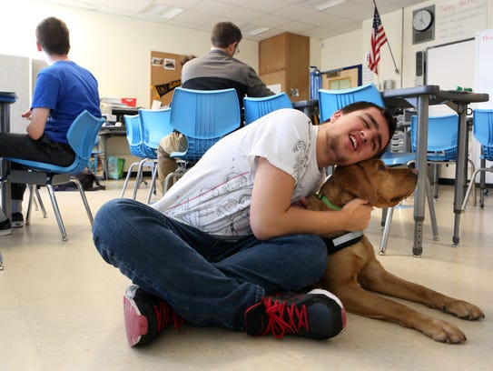 Christian Townsend, 16, spends time with Ramona, a