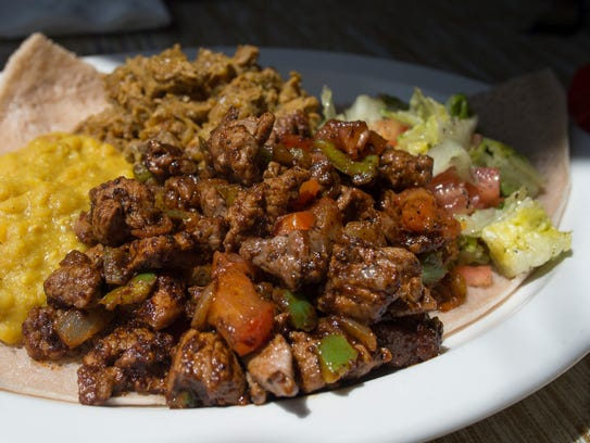Lamb tibs and lamb alicha is served with yellow split