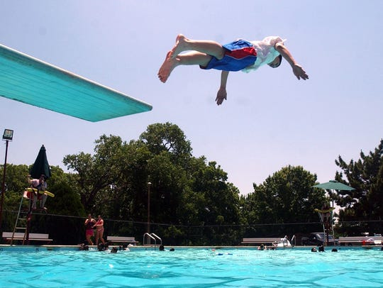 A swimmer at the Lucy Park Pool takes the plunge in