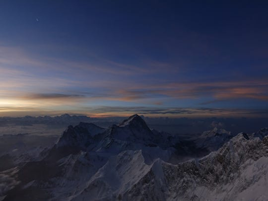 Sunrise over the Himalayas, from near the summit of Mt. Everest.