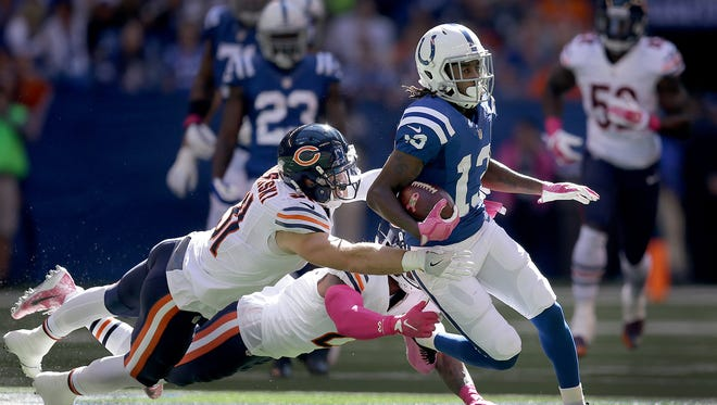 Indianapolis Colts wide receiver T.Y. Hilton (13) runs away from Chicago Bears strong safety Chris Prosinski (31) and Tracy Porter (21) in the first half of their game. The Indianapolis Colts host the Chicago Bears in their NFL football game Sunday, October 9, 2016, afternoon at Lucas Oil Stadium.