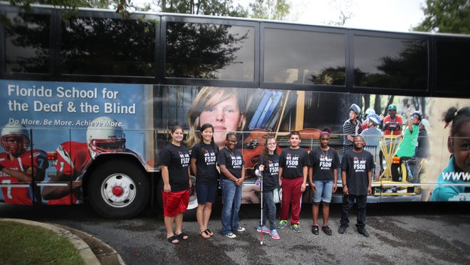 Every Sunday, a charter bus from Florida School for the Deaf and Blind picks up seven students in Tallahassee on a route from Pensacola to St. Augustine. Every Friday, they return following the completion of the school week. L-R: Savannah McCord, Julia Kadzis, Destinee Germany, Madison Woodward, Javier DiGonzalez, Laquasia Gilbert, Floyd Veal