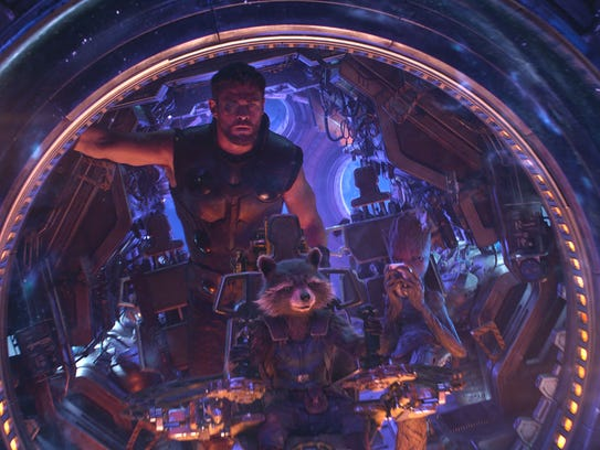 Thor (Chris Hemsworth, left), Rocket (voiced by Bradley