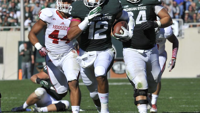 MSU's R.J. Shelton scores on a 34 yard run in the 4th quarter against Indiana at Spartan Stadium in East Lansing Saturday 10/12/2013 . (Lansing State Journal | Rod Sanford)