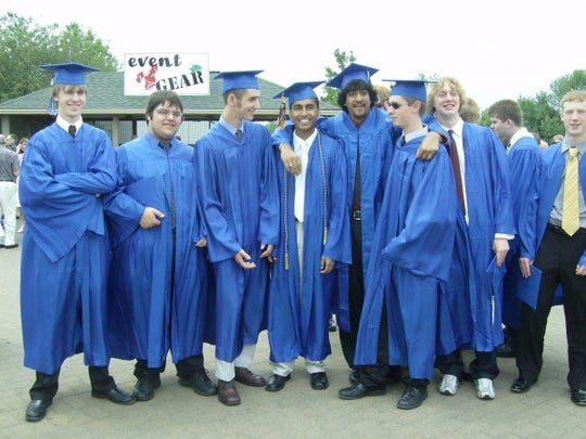 Tarun Gangwani (center, with open gown) stands with friends at his graduation from Carmel High School in 2007.