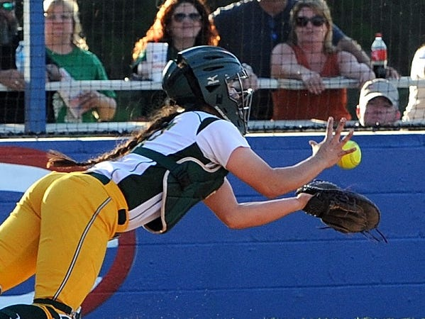 Calvary's Emily Daniel makes a diving catch during Monday's win over Evangel.