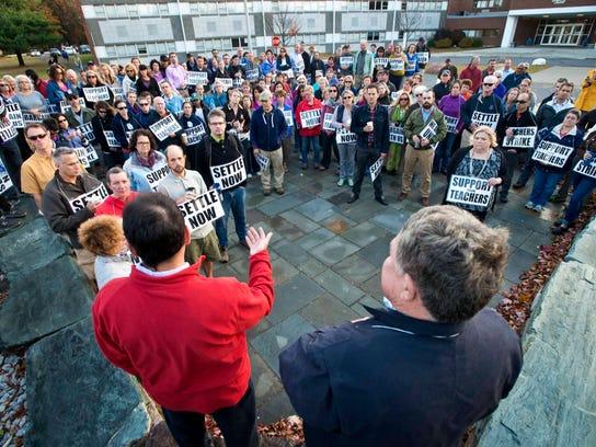 Union members Greg Wolf, left, and Richard Wise address
