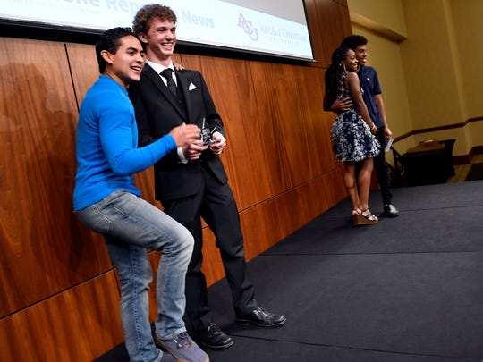 Star Student Noah West poses for a picture with his church's youth leader, Danny Zipprich, after Tuesday's Star Student Awards banquet at Abilene Christian University.