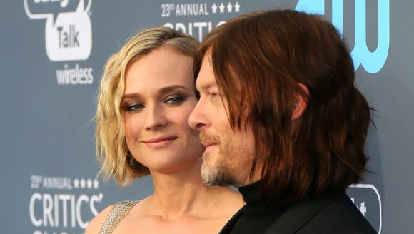 Diane Kruger, left, and Norman Reedus arrive for the