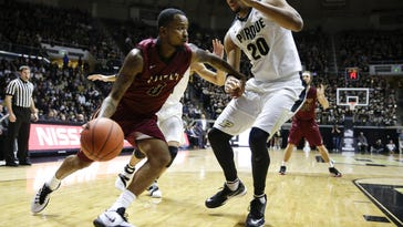 FILE --- IUPUI guard Darell Combs (0) drives under Purdue center A.J. Hammons (20) in the first half of an NCAA college basketball game in West Lafayette, Ind., Monday, Dec. 7, 2015. (AP Photo/Michael Conroy)