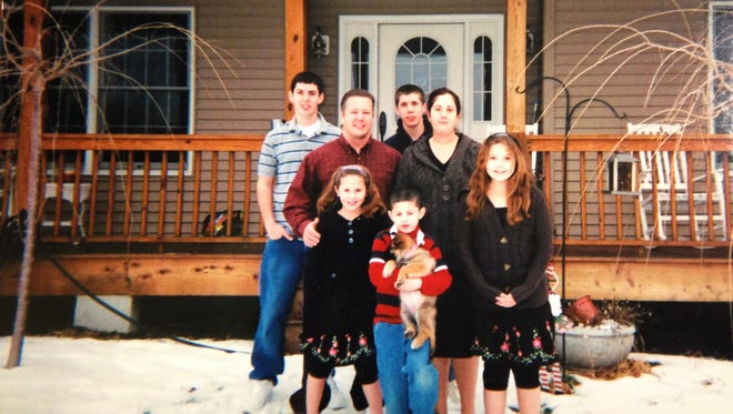 The best of times: The Boldman family in front of their dream home in Blairstown about 10 years ago.