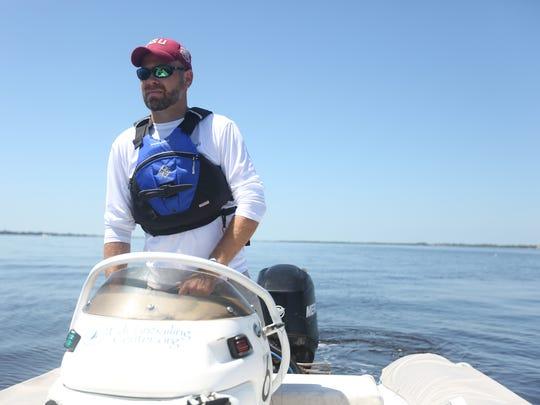 Captain Jason Dunwody mans the inflatable power boat