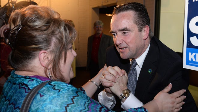 Green Bay Mayor Jim Schmitt thanks supporter Patty Kiewiz at Titletown Tap Room after winning re-election to a fourth term on Tuesday.