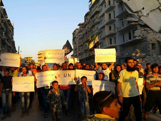 Activists in Syria's besieged Aleppo protest against