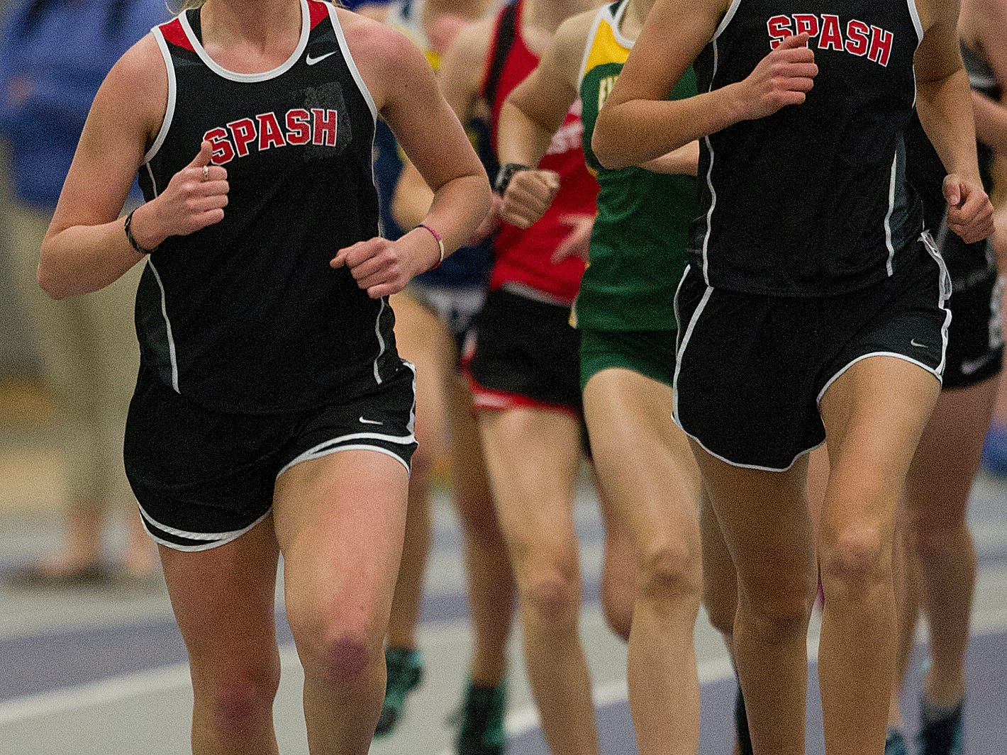 Stevens Point Area Senior High's Hannah Beilke, left, and Mya Zajakowski, right, compete in the 1,600 meters at the Wisconsin Valley Conference indoor track meet at the University of Wisconsin-Stevens Point.