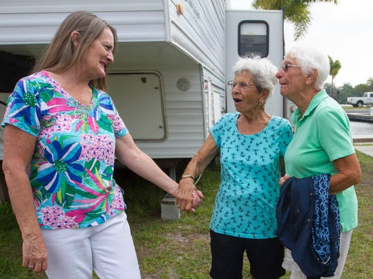 San Carlos RV park owner Carolyn Morrissette, left, and Gerry Smalley, right, say goodbye to Jo Rogers on Friday.