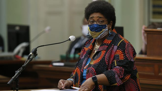 Assemblywoman Shirley Weber, D-San Diego, wears a face mask as she calls on lawmakers to create a task force to study and develop reparation proposals for African Americans, during the Assembly session in Sacramento on Thursday. The Assembly approved the bill that now goes to the Senate.