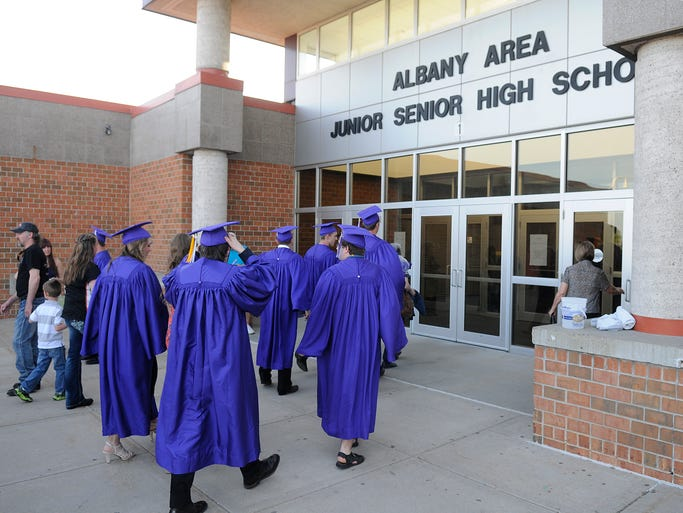 Albany students walk into their school for Friday's graduation ceremony at Albany High School in Albany.