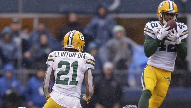 Green Bay Packers' Morgan Burnett intercepts the ball in the fourth quarter.  The Green Bay Packers against the Seattle Seahawks during the NFC conference championship game Sunday, January 18, 2015, at CenturyLink Field in Seattle, WA. Wm.Glasheen/P-C Media
