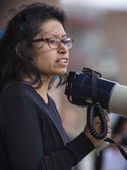University of Vermont student Marylyn Rogel speaks before several hundred people who marched to the Waterman Building at the University of Vermont in Burlington on Friday during a demonstration in solidarity with the students at the University of Missouri and to protest racism locally.