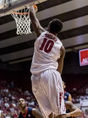 Alabama forward Jimmie Taylor scores against Mississippi