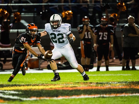 Hanover's Andre Cabon reaches out for a fumbled ball