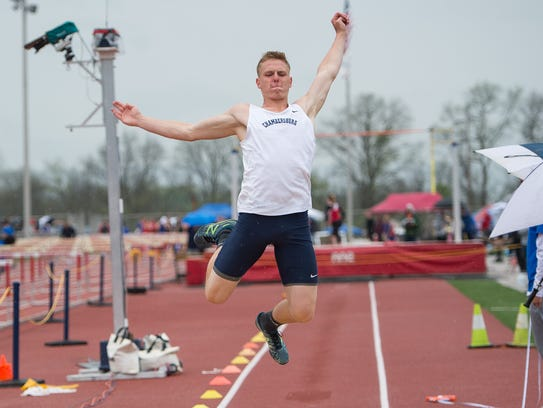 Chambersburg's Nate Reed competes in the boys 3A long