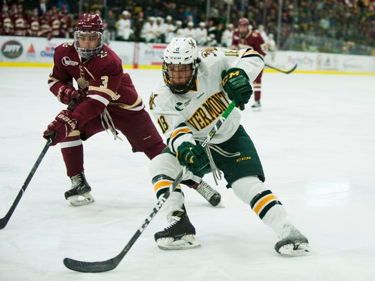 Vermont defenseman Matt O'Donnell (18) skates past